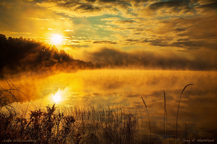 Glorious sunrise with fog on Lake Wassookeag, Dexter, Maine