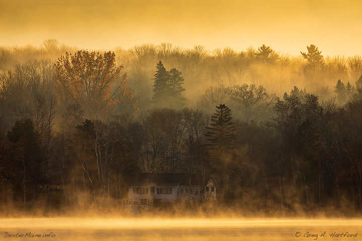 This is a sunrise looking across the small Lake Wassookeag in Dexter on a foggy morning.